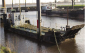 Non-propelled deck barge with loading flap